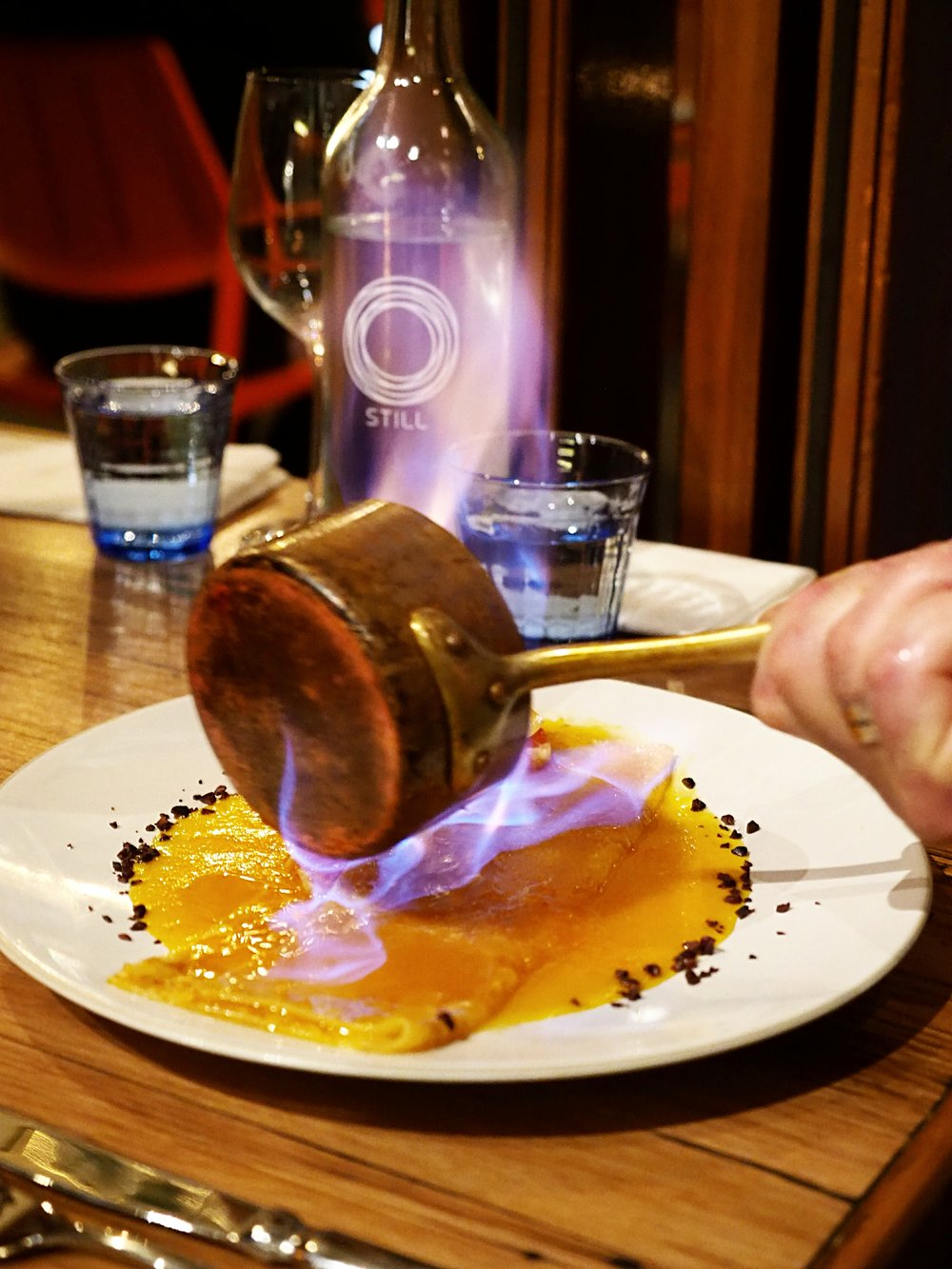 Crepe Suzette (flambee): caramelised sugar, orange butter, orange peel, Grand Marnier