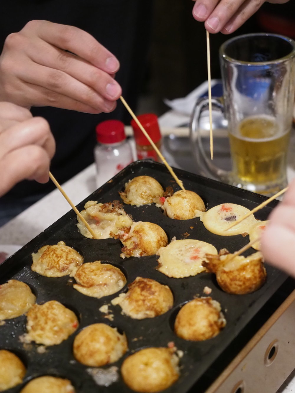 Flipping the takoyaki at Kushikatsu Tanaka