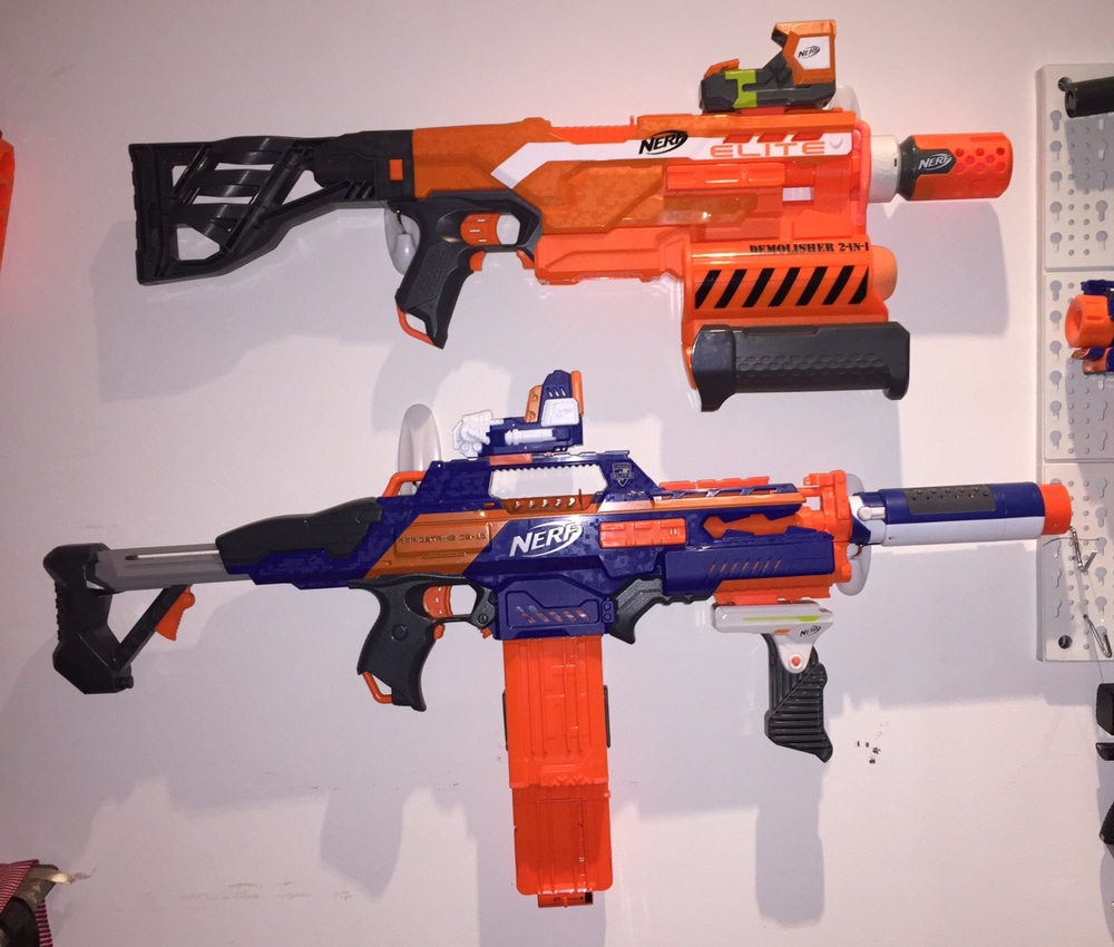 Demolisher with Modulus Pin Point Sight and Proximity Barrel.  Rapidtrike with original Pin Point Sight, Flip Clip, Pivot Grip, and Spectre barrel.