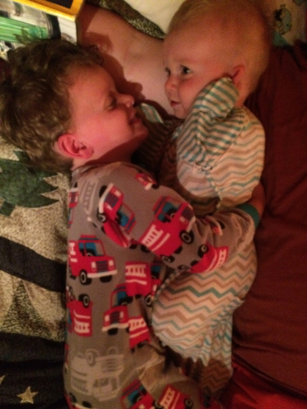 Just before bed, cuddled up next to Dad. These boys increasingly adore each other!