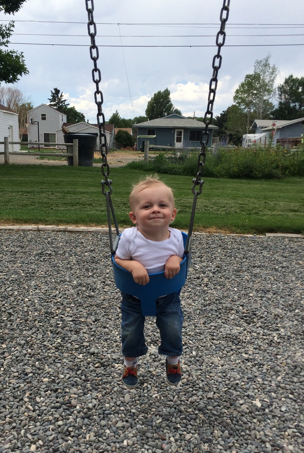 "Oh, that face. He was smugly content just to swing idly back and forth, while Asher constantly insisted I push him more so he could ""Touch da sky!"""