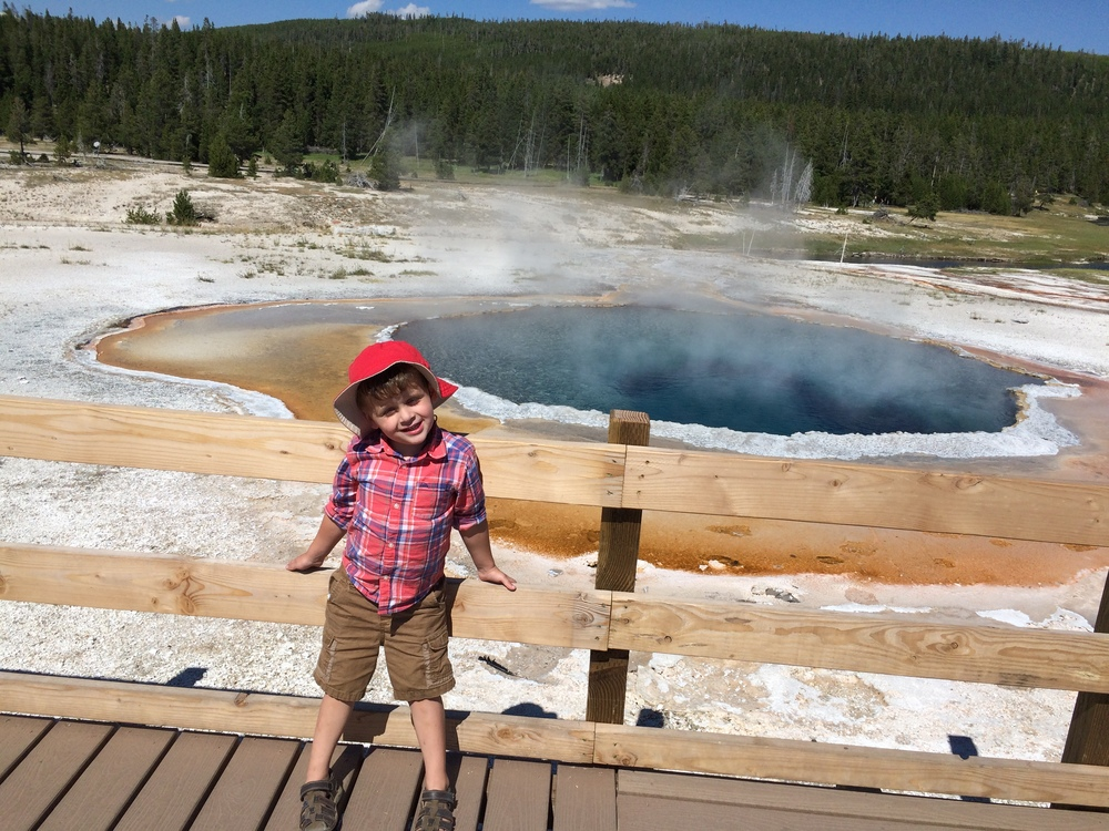 "I did my best to explain hot springs and geysers. He was mostly mollified, though always on the lookout for that ""gocano."" Everything I told him, he repeated to Grandma, Grandpa, and random tourists. I believe he has a promising future as a park tour guide. When Grandpa asked, ""Where did you learn all of this?"" Asher replied, ""In Cowowado."""