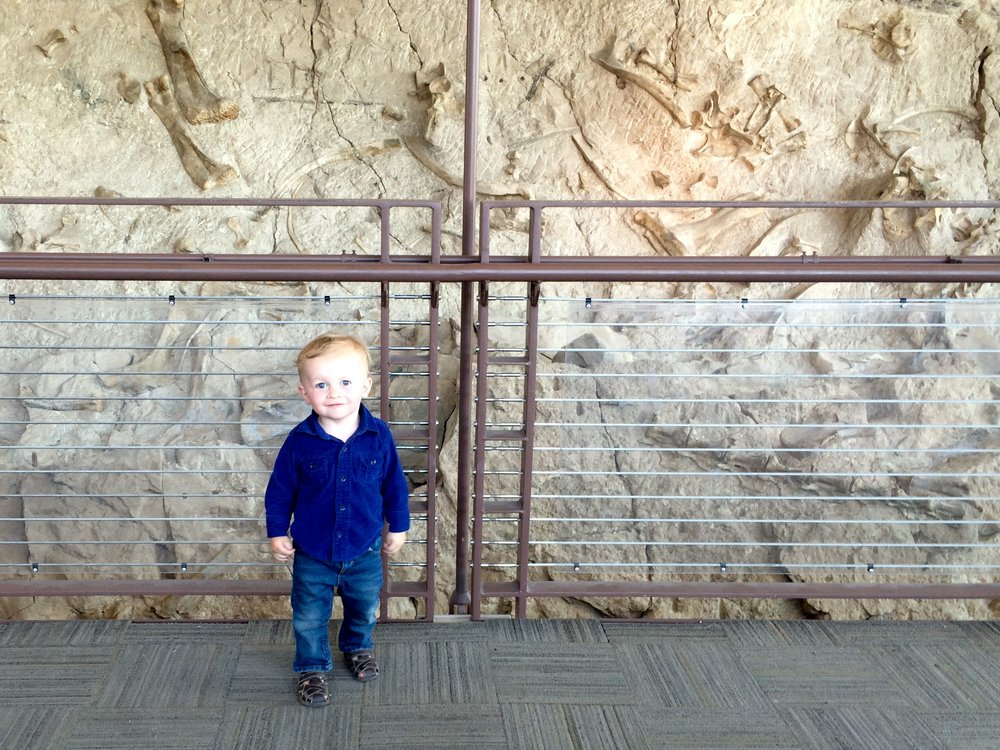 Finn posing in front of the wall of bones.