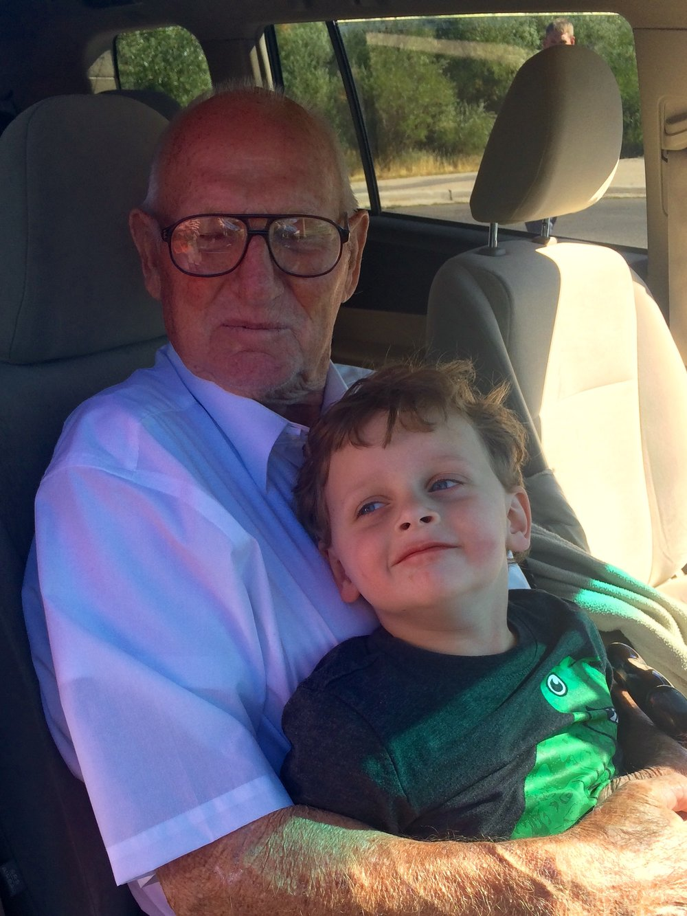 I somehow have no pics of the wedding we attended or the homecoming (two of Dave's cousins), but we did get to see a lot of Dave's family. Here is Asher on Great Grandpa Brinkerhoff's lap. Great Grandpa Brinkerhoff is almost a third parent to Dave.