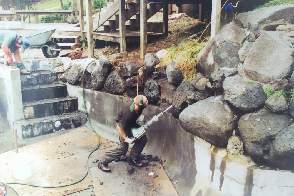 Initial construction on pool, removing waterfall