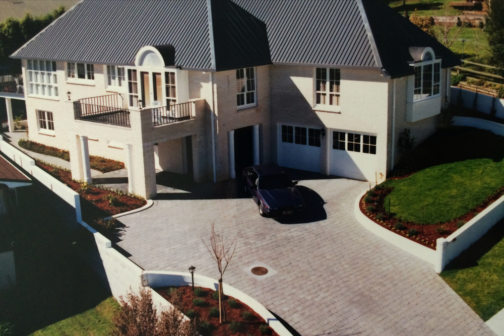 Manicured planting, grass and driveway