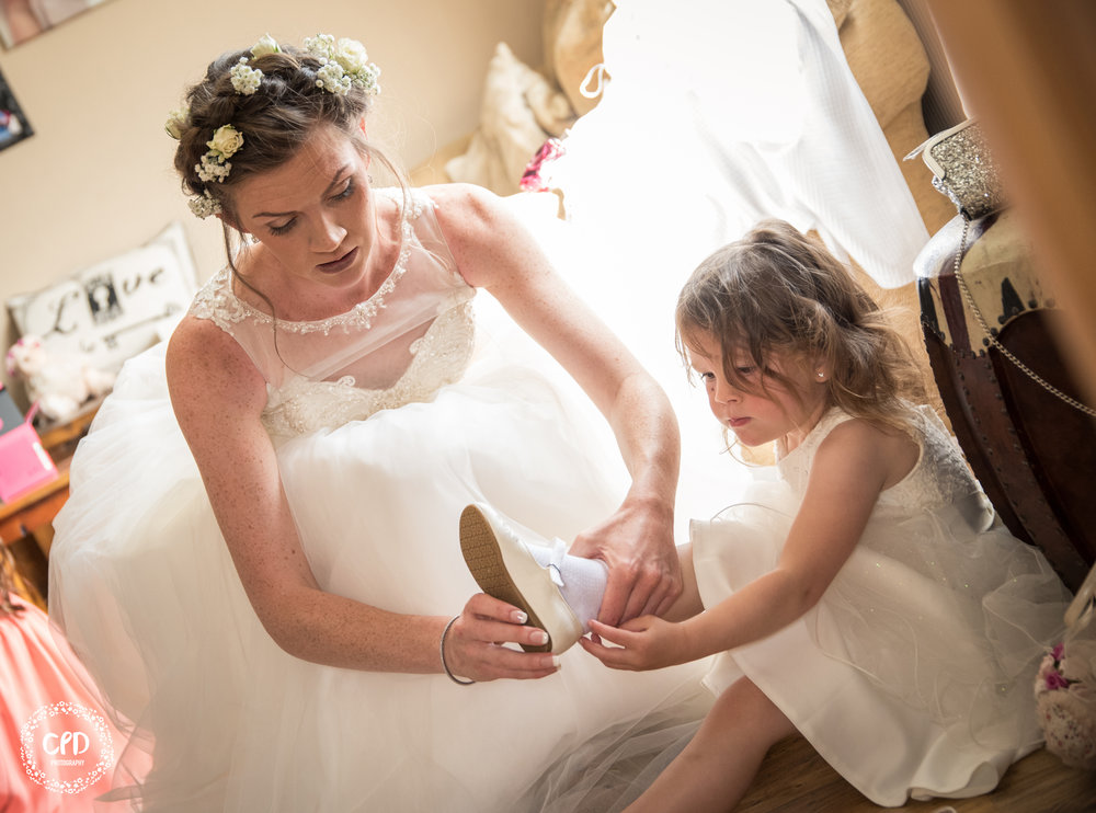 Bride putting on Bridesmaids shoes