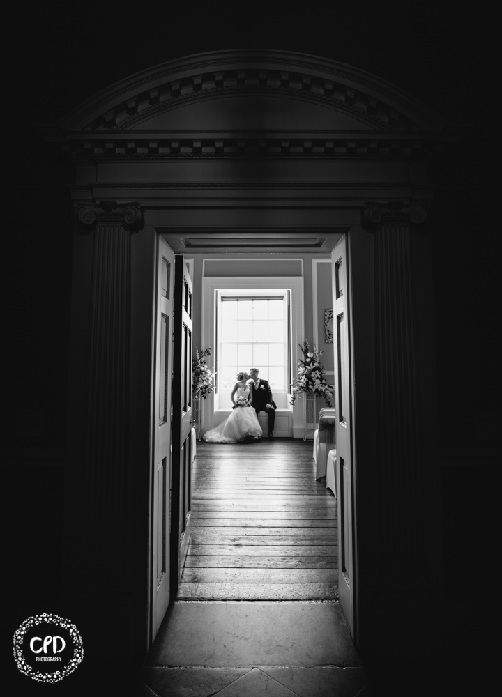 Bride and Groom in the window seat kissing