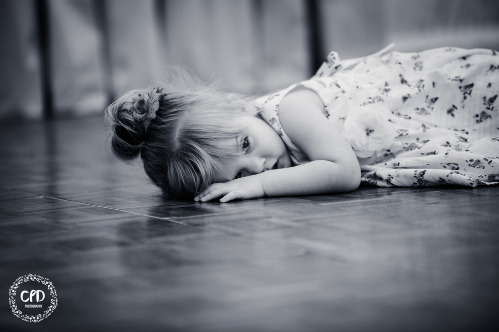 Tired little girl asleep on the dance floor