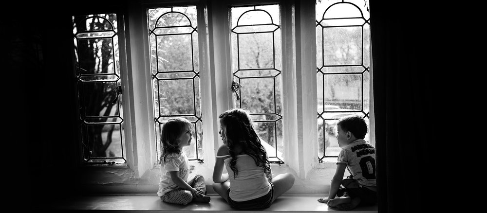 Kids playing in the window