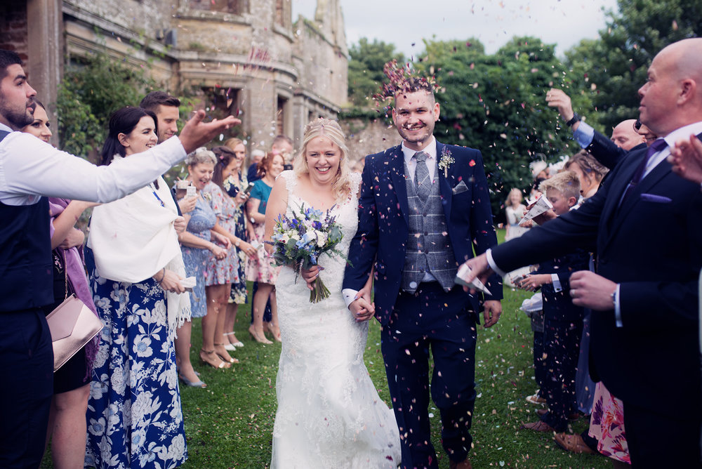 Bride and groom confetti walk