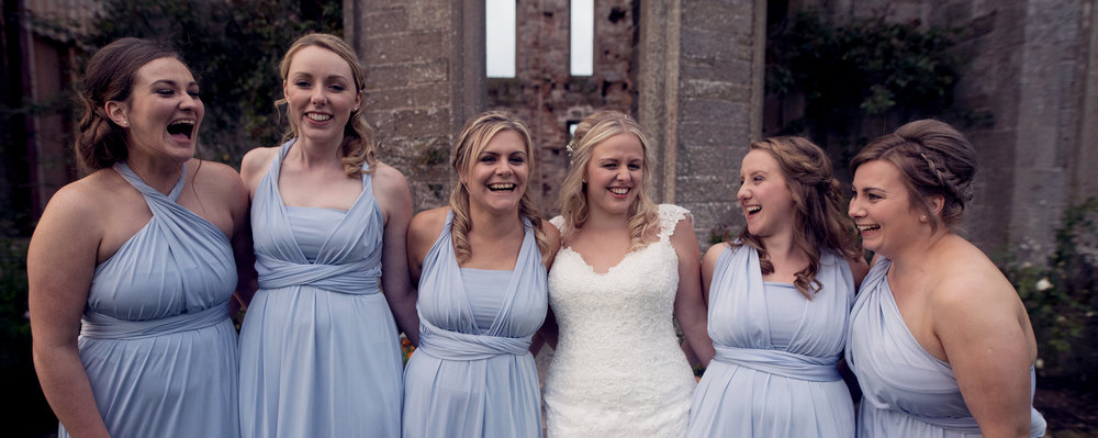 Bride and her bridesmaids having a good laugh
