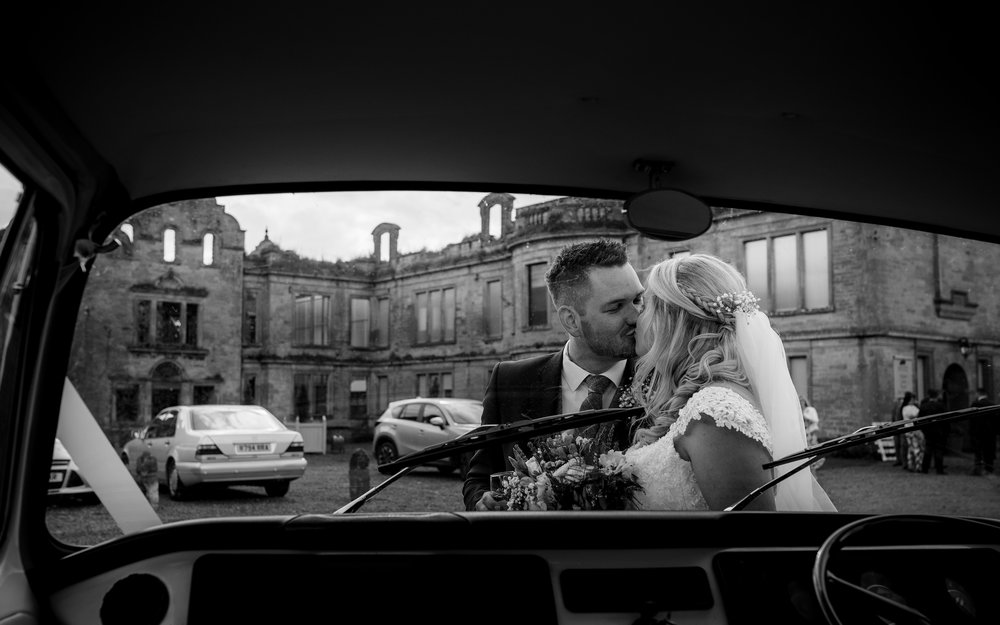 The bride and groom from inside the vw camper van