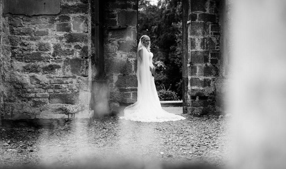 Bride only portrait black and white in a doorway