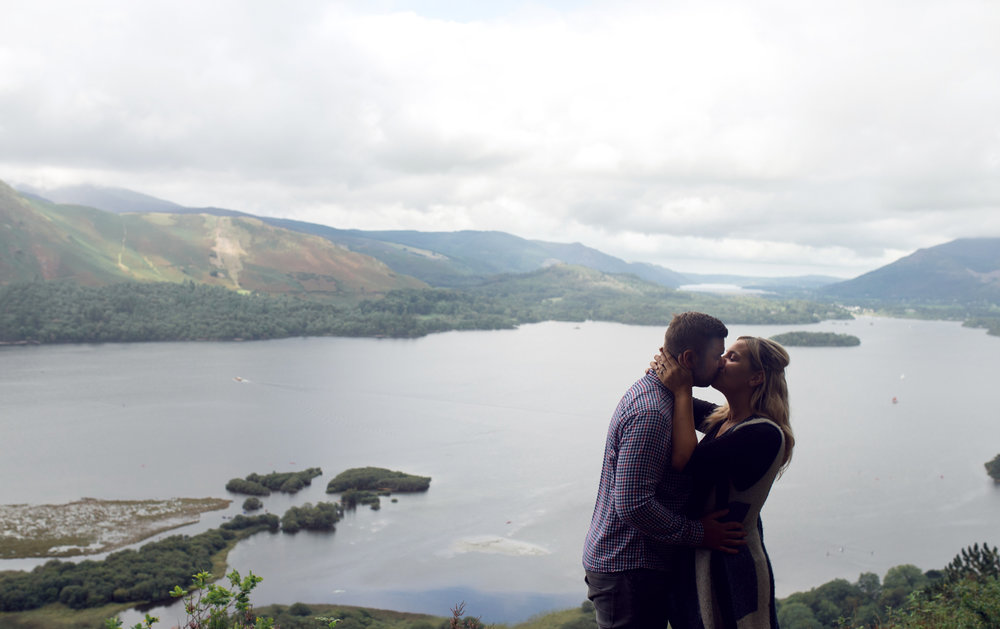 Laura and Johnny kissing with Derwent water in the background