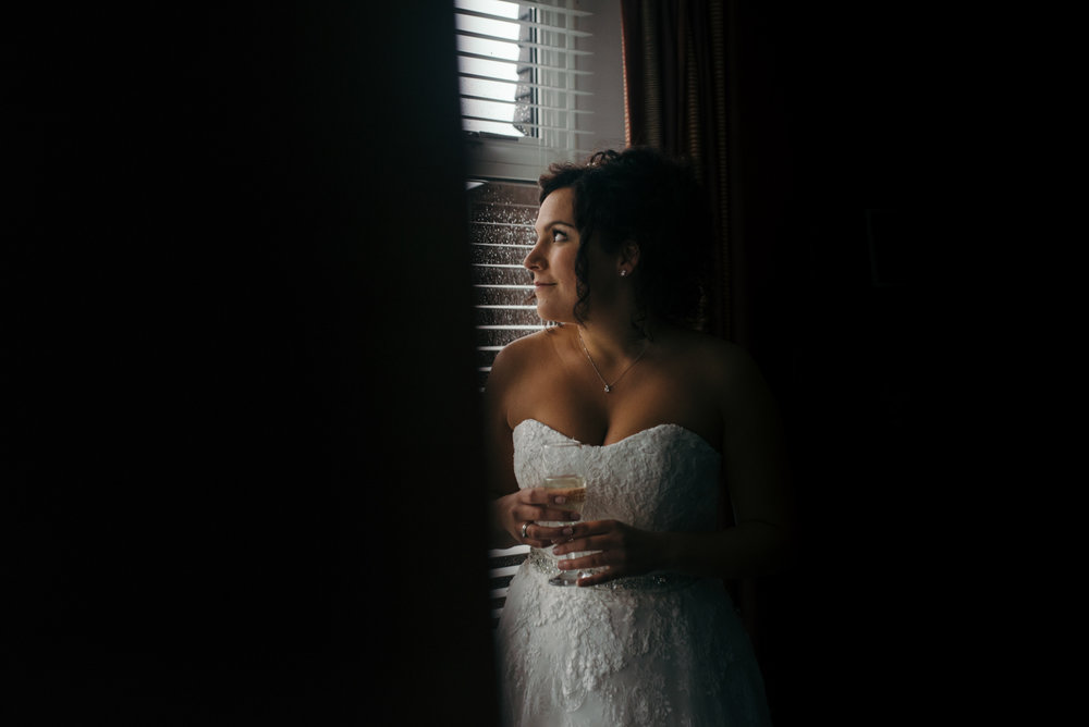 Bride portrait standing in the window