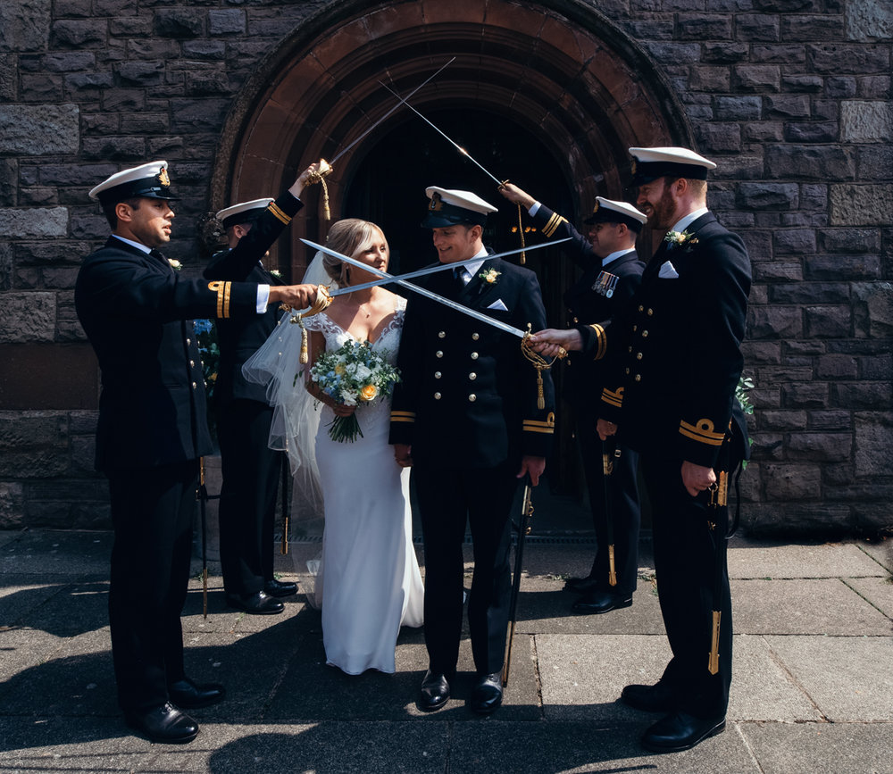 Bride and groom exit the church to a naval guard of honour