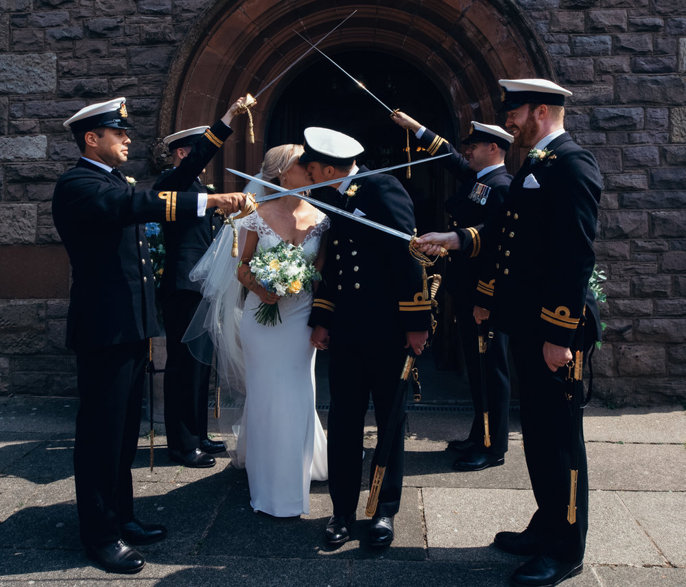 You shall not pass until you kiss exiting the church during the guard of honour