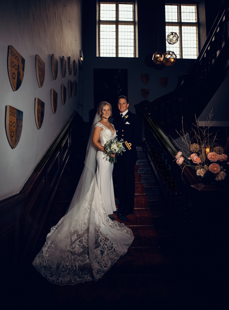 The bride and groom portrait on the stairs at Askham Hall