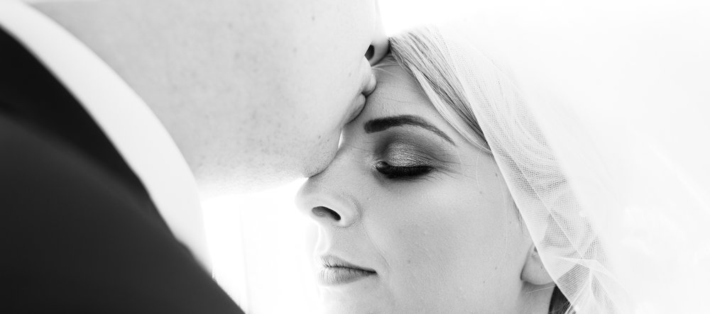 Close up image of the bride and groom in black and white