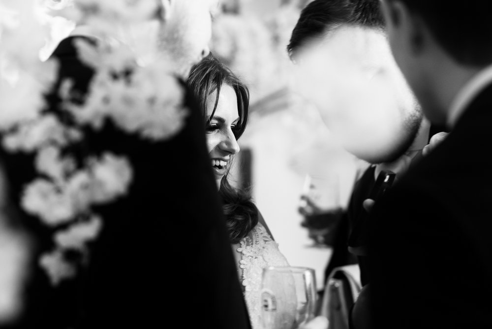 A black and white photo of the bride during the drinks reception