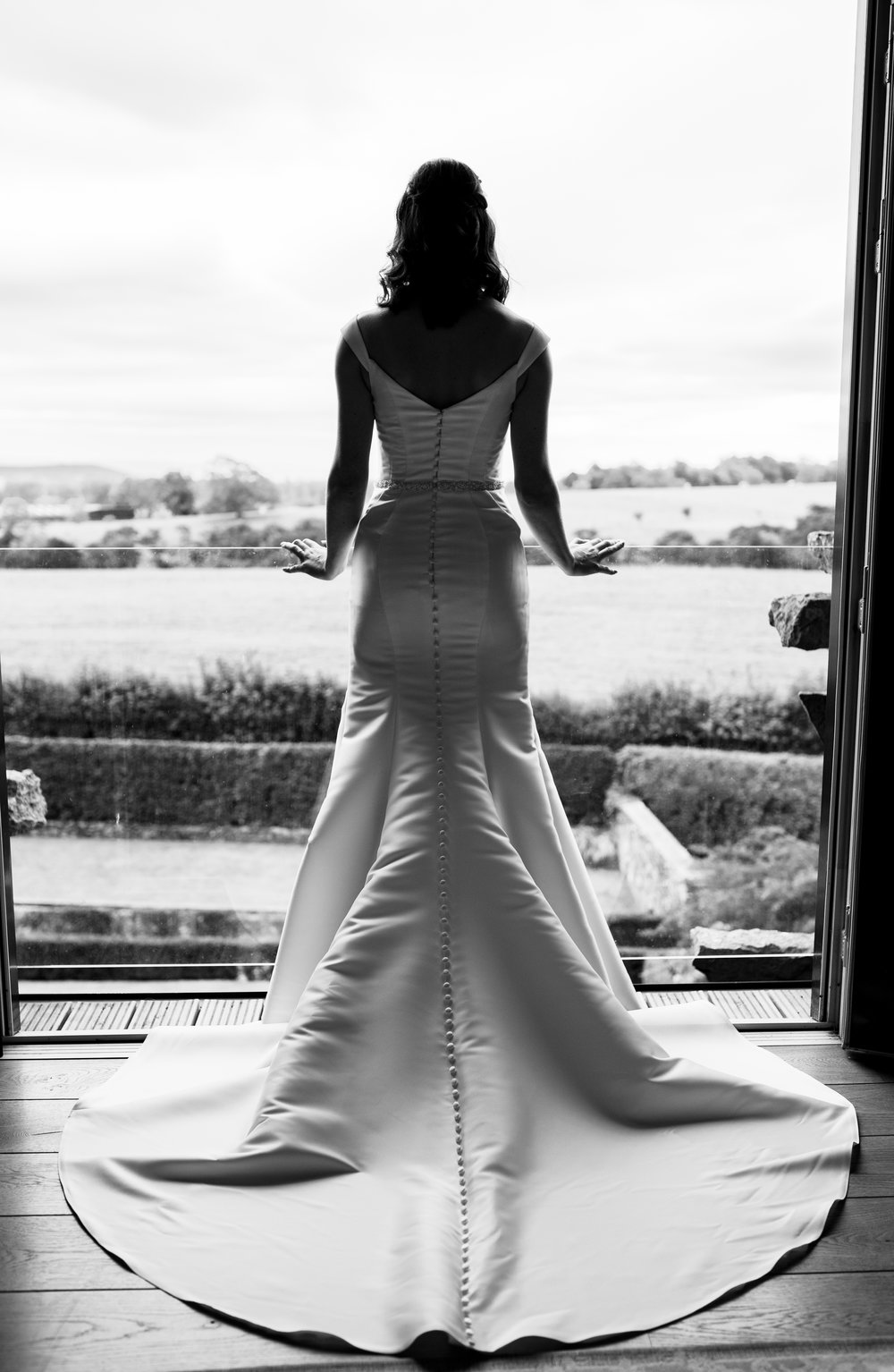Black and white photo of the bride looking out across the Cumbrian countryside