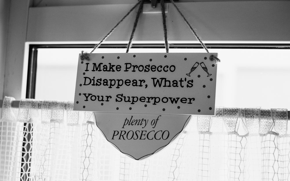 A sign in the kitchen professing the virtues of Prosecco