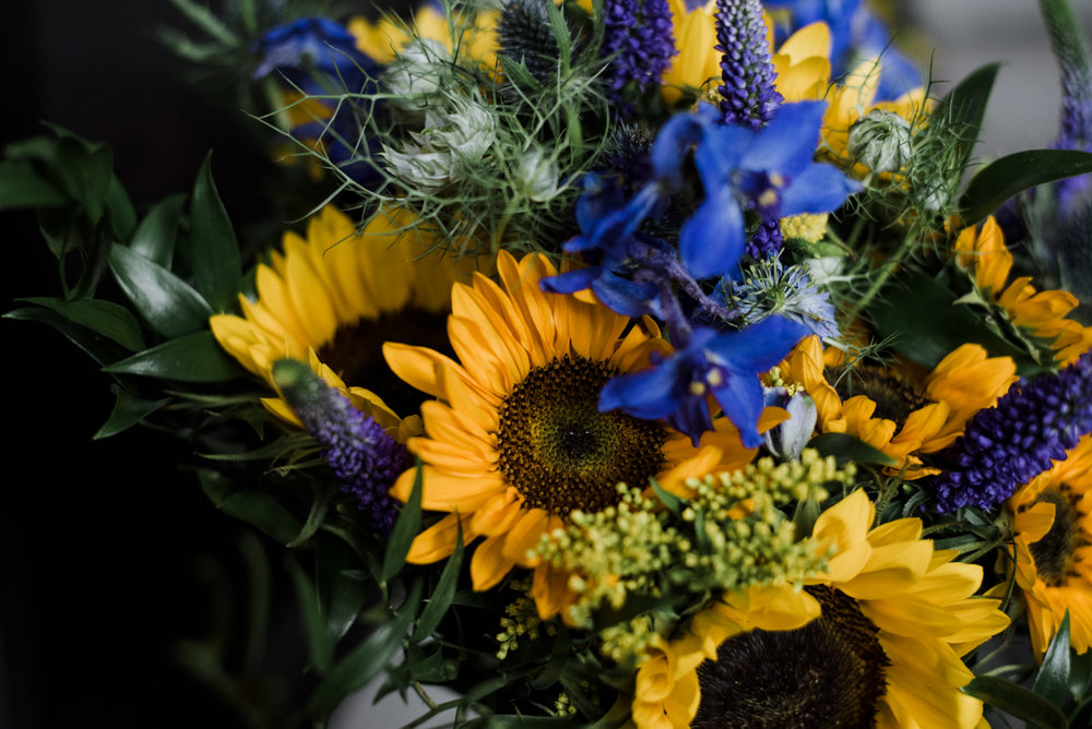 A close up photo of the brides bouquet featuring lots of sunflowers