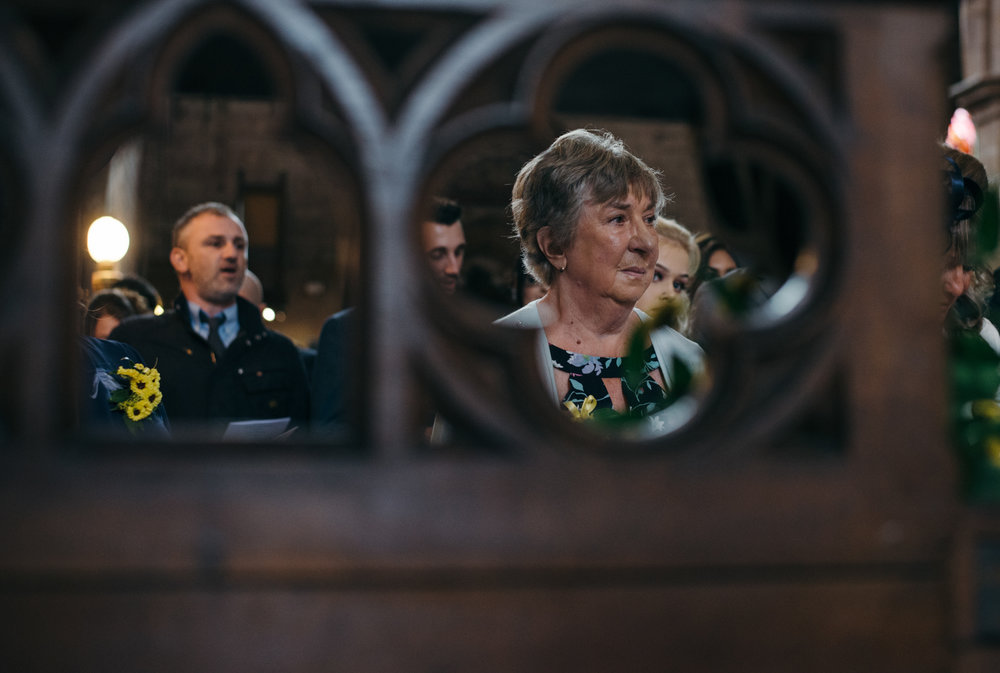 A photo of one of the guests taken through on of the screens in church
