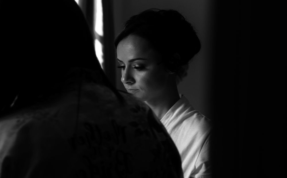 A thoughtful moment for the bride during morning preparations