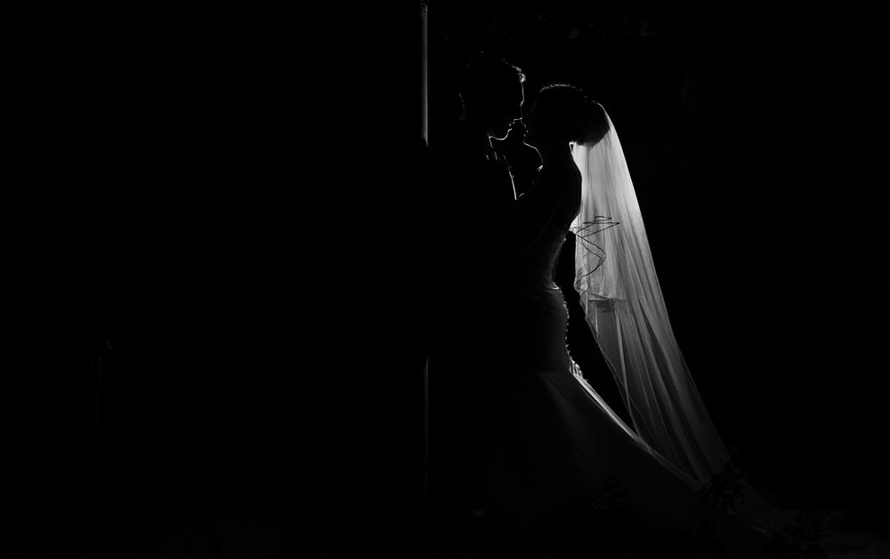 A Black and white photograph of the bride and groom taken using off camera lighting