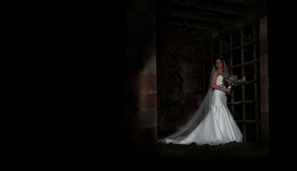 A single portrait of the bride in the alcoves at Inglewood Manor at night time