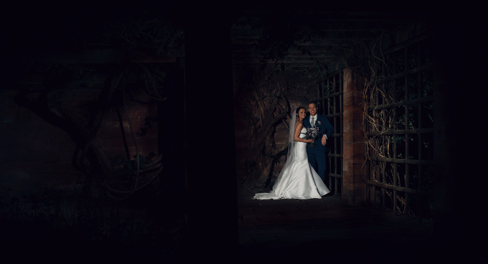 A portrait image of the bride and groom taken in the dark at Inglewood Manor