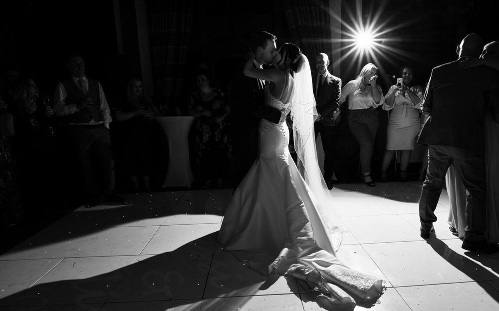 A black and white image of the bride and groom taken during their first dance together