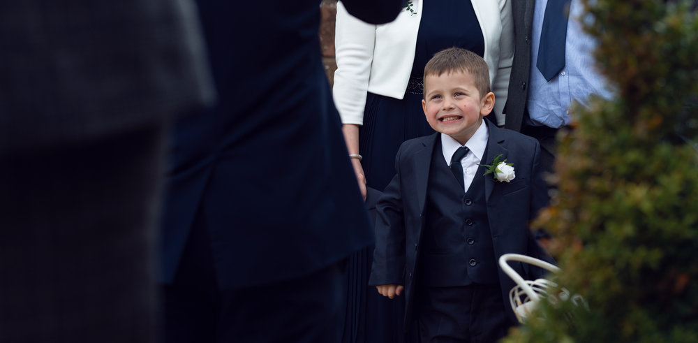 A young boy having a giggle outside the wedding venue
