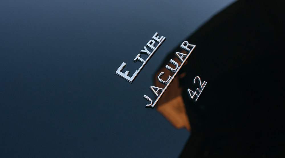 The sign on the boot of the classic e-type jaguar car outside abbey house hotel