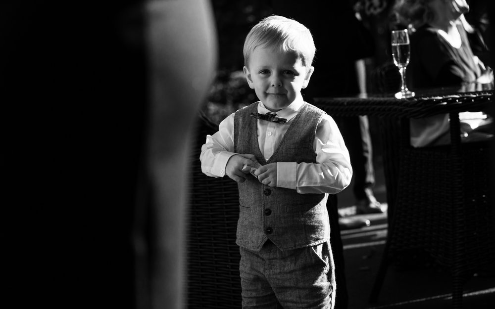 Black and white photo of one of the younger wedding guests