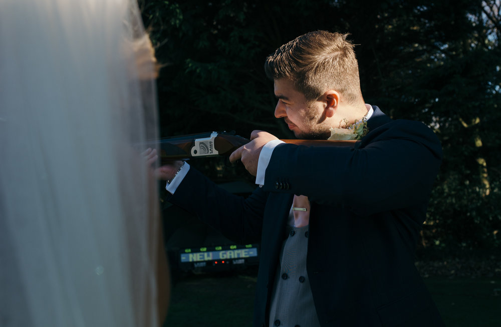 The groom trying his hand at laser clay pigeon shooting