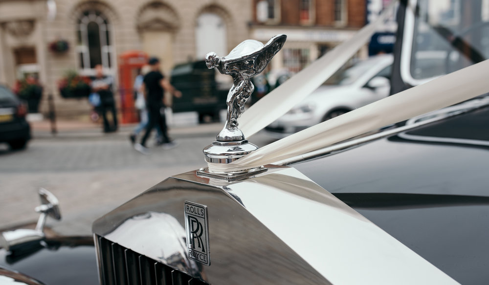 The silver lady on the front of the Rolls Royce as it arrives at the church