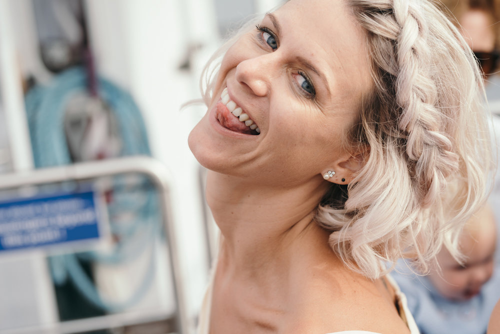 A bridesmaid pulling a funny face during the lake cruise