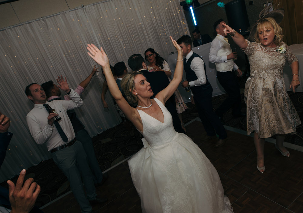 The bride making some serious shapes on the dancefloor