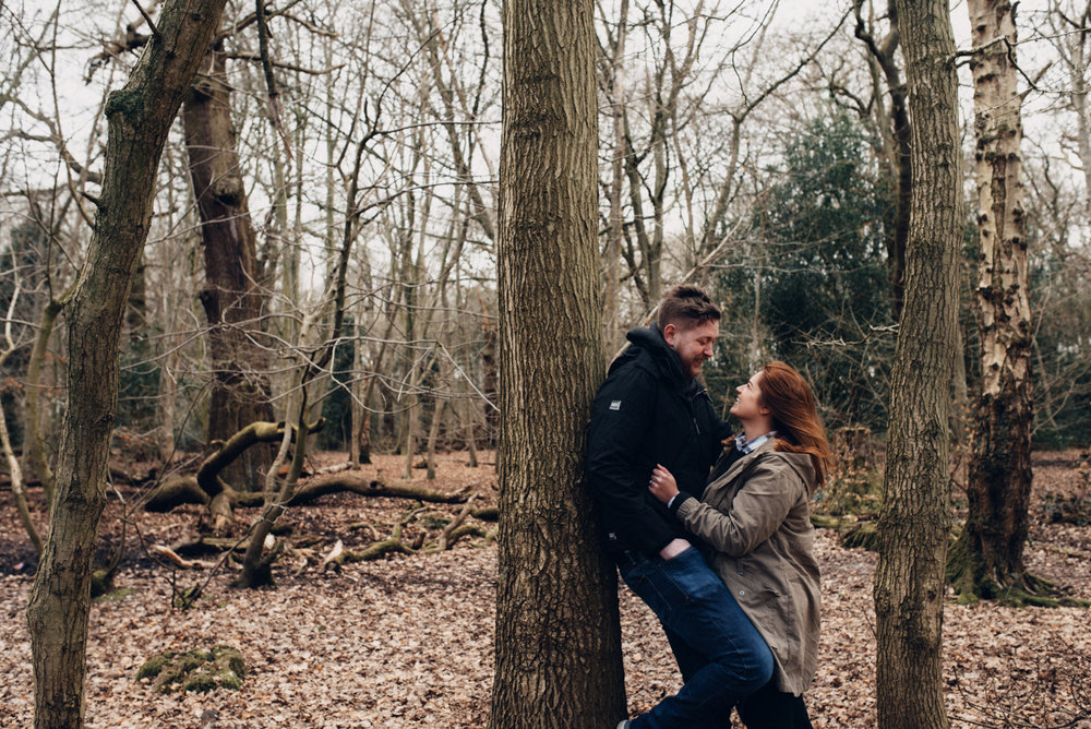 Pre shoot a couple in the woods having a giggle