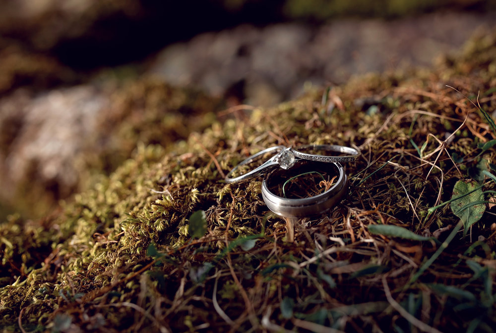 Pre shoot - The brides engagement ring on a moss covered rock at Derwent Water in The Lake District