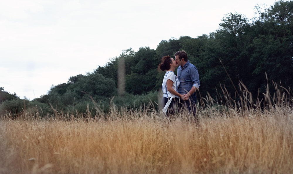 Pre shoot - A couple kissing in a field
