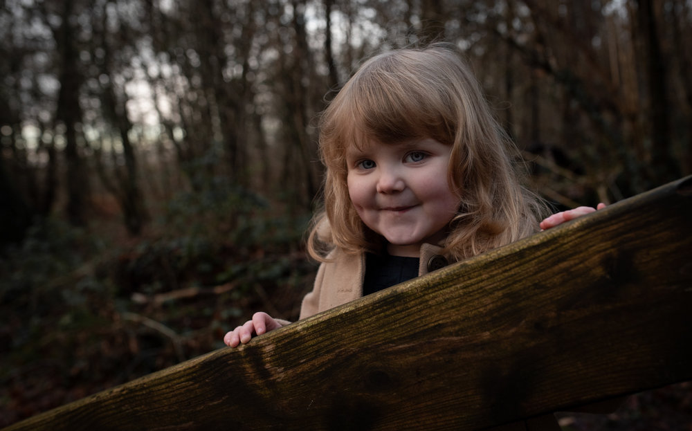 Little Rosie posing on the bridge in the woods