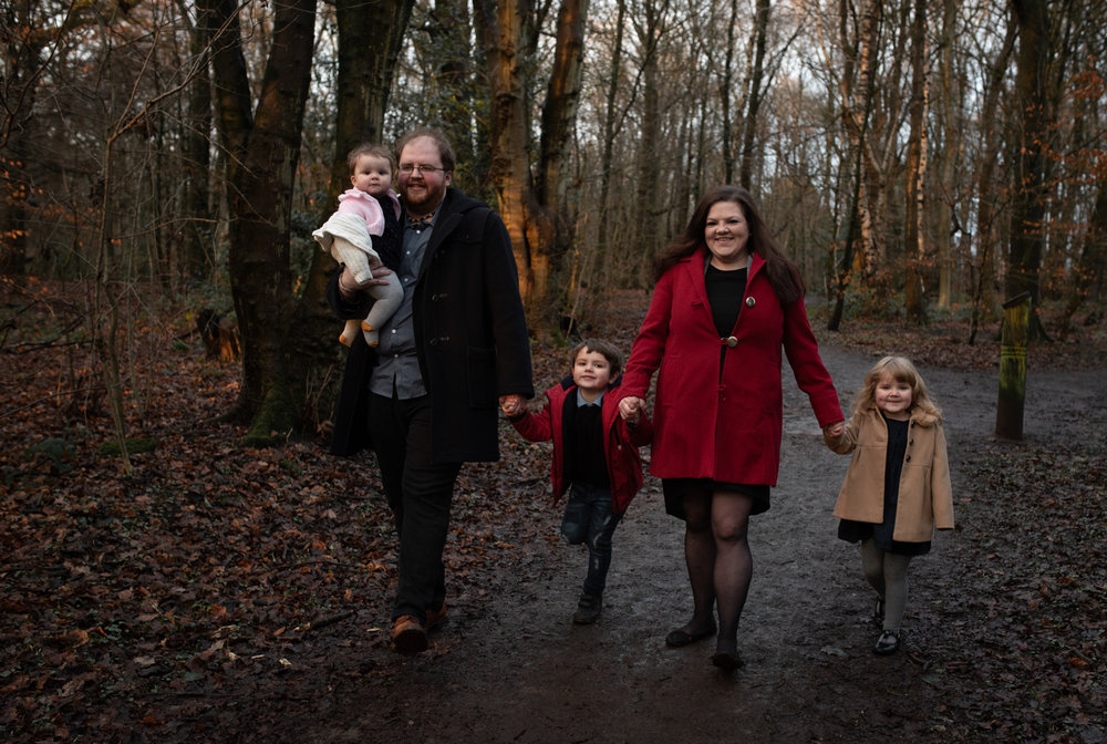 A family group walking in the woods