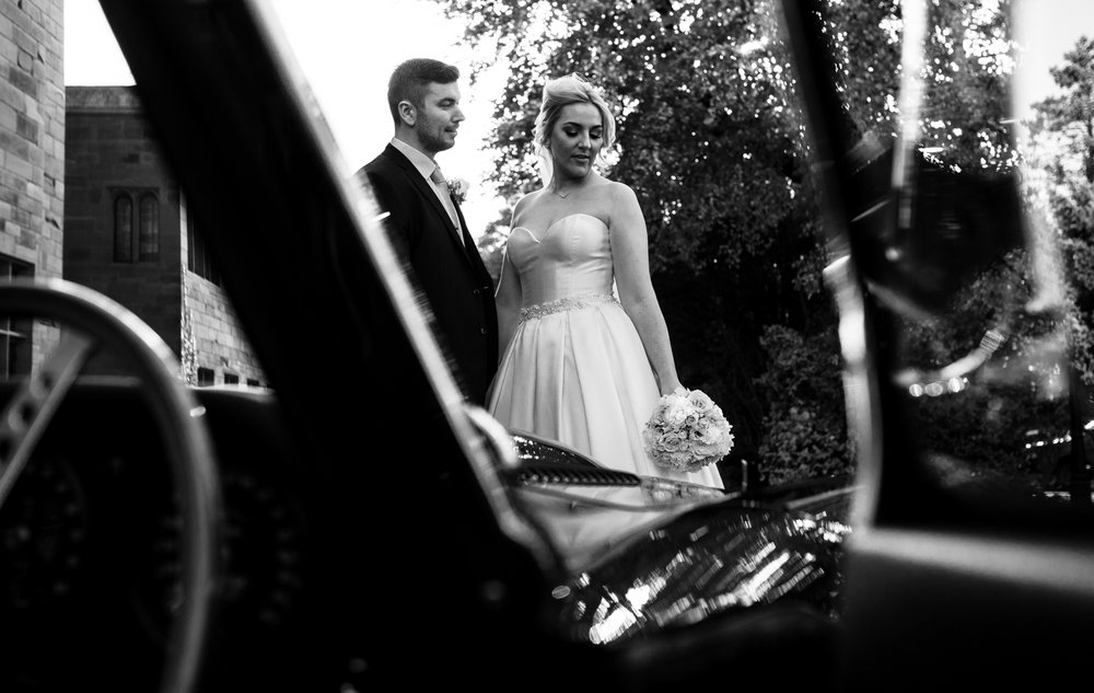 Bride and Groom portrait with the MG sports car at Abbey House hotel