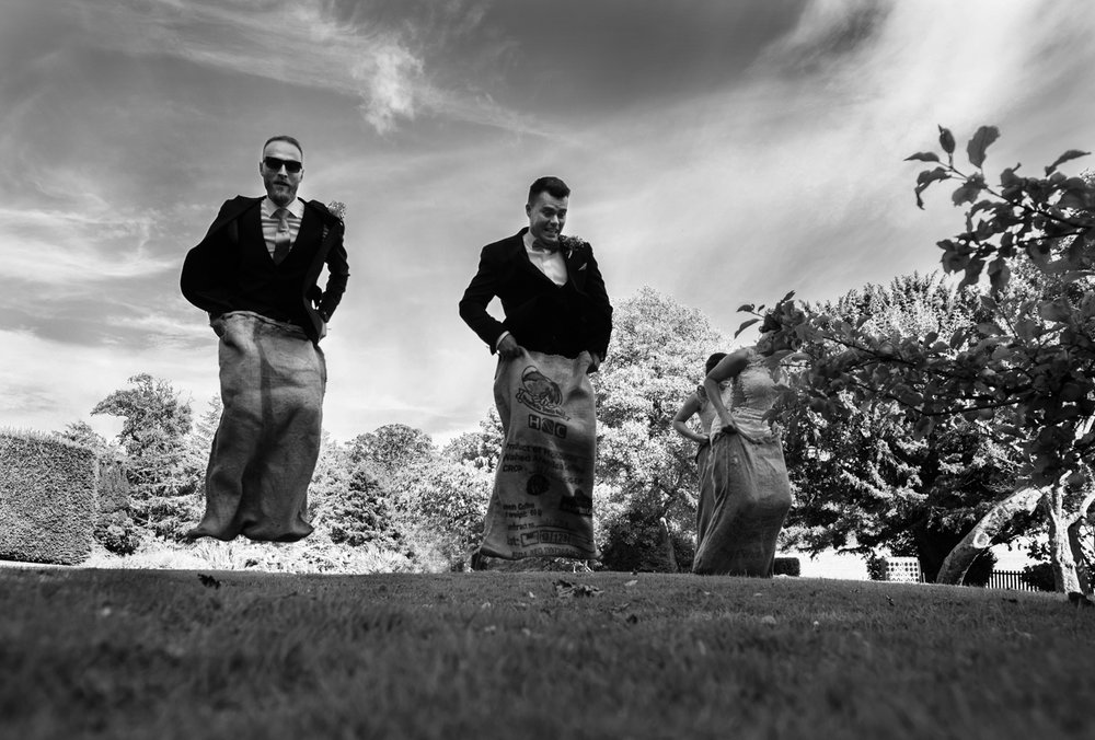 Black and white photo from the sack race at Blaithwaite House Orchard Garden