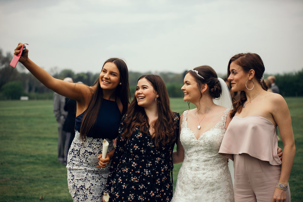 The bride and some of her friends taking a selfie.jpg