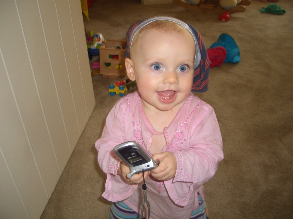 Kaya employs tactile and visual learning here - wearing her brother's undies on her head and mum's old phone safe in two hands!
